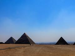 Pyramids of Khufu, Khafre, Mankaure and Queens - 01 (MikePScott) Tags: camera sky monument cemetery grave buildings pyramid tomb egypt mausoleum ecclesiastical giza builtenvironment pyramidofkhafre panasonicdmcfz30 alharam pyramidofkhufu pyramidsofqueens pyramidofmankaure featureslandmarks