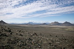 Northeast Icelandic Desert (Robiats) Tags: travel blue sky black mountains clouds canon landscape iceland sand rocks desert stones hills fields desolate vast