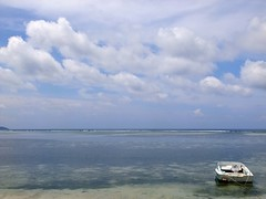 Serenity in an Island (yusuf ks) Tags: serenity waterisland air gili giliair beach pantai seascape beautifulbeach bluebeach landscape nature alam clouds awan sky langit boat island pulau nusatenggarabarat ntb westnusatenggara lombok indonesia