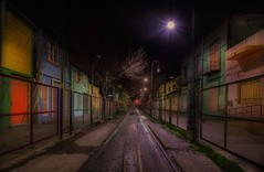 Buenos Aires streets at night (karinavera) Tags: travel nikond5300 street road longexposure caminito lines night barrio buenosaires trail capital decay laboca urban wallart nopeople argentina capitalcities tourism urbanexploration colors train