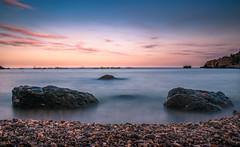 Taormina Sunset (Naebula) Tags: rosso taormina tramonto sunset sicilia sicily italia italy sea mare longexposure longexposition lungaesposizione red stones cliff rock water acqua isola bella