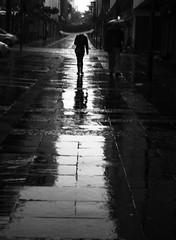 Urban rain (mara.arantes) Tags: urban street monochrome rain city people digital rua chuva dramatic umbrella pb