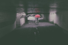 Red (tomorca) Tags: umbrella bicycle people street woman
