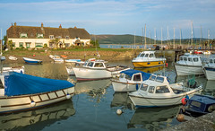 Evening sunlight on Gibraltar cottages and boats in the harbour at Porlock Weir in Somerset (Anguskirk) Tags: boats england harbour porlockweir somerset topazdenoise uk