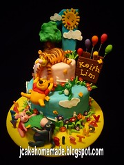 Winnie the Pooh birthday cake (Jcakehomemade) Tags: sun tree balloon frog homemadecake partycake designercake poohcake tiggercake pigletcake eeyorecake childrenbirthdaycake winniethepoohthemebirthdaycake kidsfuncake kidsnoveltycake cakefor1stbirthday cakesbyjessicalawwwwjcakehomemadeblogspotcom