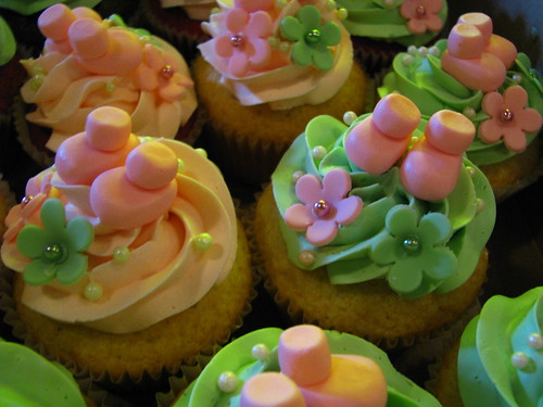 baby shower cupcakes: little booties and flowers