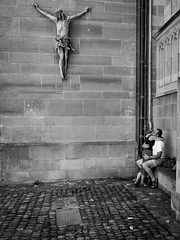 blessed (streetwrk.com) Tags: street people bw church monochrome germany blackwhite couple jesus streetphotography stranger sw streetogs streetwrk