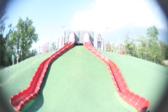 wheeeee (Maicdlphin) Tags: park red summer hill fisheye slides assiniboine tawnee sooc