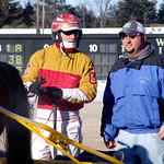 92 - race 6 - Eric Carlson behind Catch This Kiss (#1) in the winner's circle thumbnail
