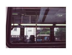 The Two O'clock 12 Line (James Eleftherion) Tags: leica arista rapid e6 slide developing kit homedeveloped fujifilm fuji provia 100f nyc manhattan streetphotography afternoon summer film slidefilm minilux analog filmisnotdead epson v600 geometry window bus commuter shadow usnormies rain