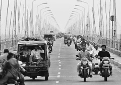To and fro (kissoflif3) Tags: road bridge street traffic inthetraffic middleoftheroad india vehicles twowheelers auto sharingauto rajahmundry pushkaralu godavari people driving riding way path