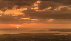 Looking West (Glenn D Reay) Tags: wales snowdonia menaistrait sunset coastal warm clouds sun anglesey yfron llanddwynisland trmawrlighthouse pentaxart pentax k30 pentax50200wr