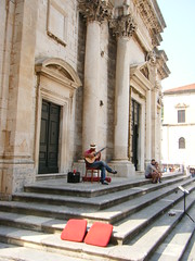 Dubrovnik, Croatia, guitarist (rossendale2016) Tags: ionic boots jeans neolithic gothic masonic masonry stonemason crved ornate walled melody tune singing strumming tripod stand hat straw chair seat amplifier speaker cup coffee red mug drink architectural pillar stone holidaymakers holiday tourism tourist musician music guitar fourist old square seats large pillars steps city serenading guitarist croatia dubrovnik