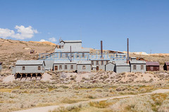 Bodie (melastmohican) Tags: california park wood old travel wild sky usa house west building history abandoned grass architecture barn yard america vintage silver gold town wooden junk mine desert state antique decay empty united ghost country rustic landmark sierra historic haunted mining nostalgia american western vehicle weathered shack bodie deserted