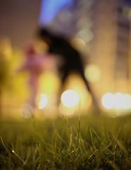 Little Dancer (Philocycler) Tags: chicago grass happy lights evening dusk joyful chicagoist littledancer bokehbuildings bokehfigures