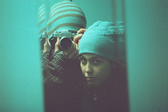 In an elevator (Andrey Timofeev) Tags: camera portrait selfportrait colour reflection film girl look 35mm mirror hands turquoise  winterhat screwmount      helios44  m39  zenit3m inanelevator  35 ferraniasolaris400   44 3  march2012 39