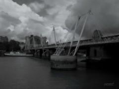 Charing Cross (Steve.T.) Tags: bridge blackandwhite london thames clouds river mono fuji dramatic hungerfordbridge charingcrossstation hs10 ommot