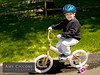 Smiling boy with helmet ridiing bicycle witih training wheels (amycicconi) Tags: boy childhood smiling bicycle youth outdoors exercise helmet riding getty fitness trainingwheels childbike gettyimageswants