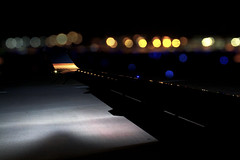 Gloomy flights. (Neymgm) Tags: travel sky black blur window field night plane canon dark eos lights fly moving airport movement focus dof bokeh aircraft air flash wing ground depth pilot 450d