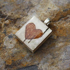 Carved heart scrabble tile pendant made from birch bark. (Kitti and Calo) Tags: original streetart art nature tattoo illustration watercolor painting outdoors graffiti necklace woods acrylic natural handmade drawing unique oneofakind cartoon paintings surreal jewelry oil dreamy organic sketches pendant whimsical penandink necklaces pendants scrabbletilependants