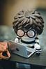 Back from school (MMortAH) Tags: toy toys 50mm glasses nikon desk bokeh designer 5 laptop 14 vinyl ren nikkor rucksack afs d90 crazylabel treeson bubiauyeung ghostb treesonandotherstories