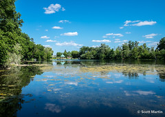 Reflections on Mill Pond (Scott Martin Calgary) Tags: milton ontario canada millpond reflections clouds pond water