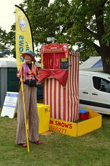 Tall Story (dhcomet) Tags: knebworth park estate house herts hertfordshire stevenage steam country crafts show fair punch judy booth stilted stilt hat tall greet