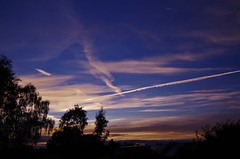 Lines and light (Sundornvic) Tags: sun sky clouds trails lines white blue contrails contrast sunset evening shropshire trees silhouette pentaxart