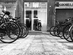 iPhone Series - In front of you (moskatomika) Tags: wheels window street dress shopping vetrina bicycle bikes biciclette biancoenero bw bologna