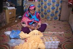 Noor Bibi manufacturing waistband. (Akhuwat BPP) Tags: sukkur pakistan interest free loans microfinance entrepreneurship pakhtoon ordinary people small business akhuwat