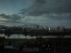 . (Elliott Fusy-Pudal) Tags: russia transsiberian russie transsiberien throughthewindow travel fromparistovladivistok siberia moscow trainstation landscape car wagon nature electricpoles ruins buidling cars horses people day night 10daysnonstop mountains plain