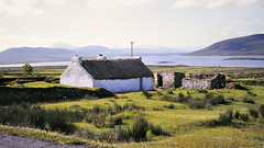 Old stone and thatch farm buildings - County Mayo, Ireland, 1978 (edk7) Tags: ocean old ireland house mountain building water stone architecture landscape farm slide eire thatch mayo 1978 countymayo nikkormat ft2 m606 edk7