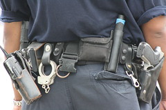 TOOLS OF THE TRADE (MIKECNY) Tags: nyc newyork brooklyn radio coneyisland belt uniform gun police equipment lawenforcement handcuffs