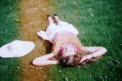 sweet suicide (maggyvaneijk) Tags: light red summer white house holiday laura holland film nature grass hat sunshine fashion flesh 35mm hair boat model focus friend arms minolta legs head band curls blonde wrist resting leak sequin brouwer