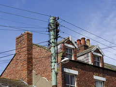 Lamp 22 (Nekoglyph) Tags: hinderwell yorkshire chimneys pots rooftop tiles green cables wires pole windows bricks walls blue urban lamp electric
