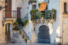 Siracusa Italy (roevin | Urban Capture) Tags: siracusa sicilia italy it balcony balconies house facade garae flower flowers city urban ancient brick building buildings door doors corner fullyfilled small street alley escher effect