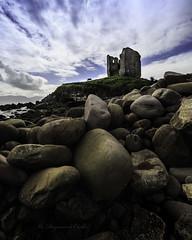 Minard Castle (cannon fodder1) Tags: minardcastle minardcastleireland stones beach boulders landscape sky castle ruin ireland minard kerry dingle horse grazing sea shore foreground