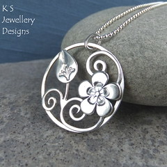 Flower and Bud Sterling Silver Circle Pendant (KSJewelleryDesigns) Tags: metalwork flower pendant necklace jewellery jewelry handmade brightsilver shine sterlingsilver silverjewellery handcrafted silver silverwire metal hammered shiny polished bright soldered soldering brushed flowers petals sawing piercing silversmith silversmithing daisy daisies blooms blossom flowerbud cherryblossom