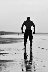 Bodybuilder (Pavels Dunaicevs) Tags: sea summer man reflection guy water sport evening bay sand body bodybuilding latvia fitness jurmala muscles mass gain diet strong ocean coast posing silhouette nikon nikkor d750 180mm 28 bodybuilder male baltic irclv terminator