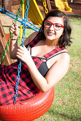 Carol (carinaferraresi) Tags: girl brunette cat eye cute smile short hair hairstyle pin up tattoo tattooed woman tie bow play joy park grass outside day time sun sunny summer childish girlie playground checkered clothes fashion red plaid outfit retro fun glasses