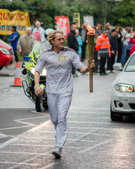 Olympic Torch Relay - Leicester (philipJvernon (www.philipJvernon.co.uk)) Tags: uk light england people white london rain proud person gold minolta leicestershire britain walk sony leicester nation pride run host flame torch beercan runners olympic alpha 450 jog relay f4 bearers 2012 70210 torchbearer a450