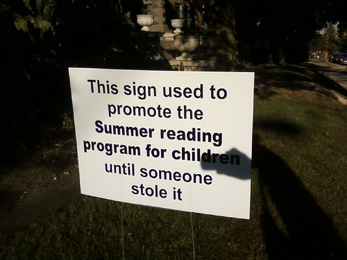 This sign used to promote the Summer reading program for children until someone stole it