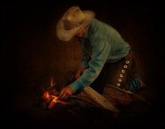 Fire Starter (Chason Photos) Tags: pictures show wood portrait horses horse brown man black art texture field cowboys portraits painting outside outdoors fire photography cow photo interestingness nikon cowboy paint flickr glow photographer shot cattle cows natural boots florida photos outdoor background flames picture textures flame photograph american western glowing cowboyhat brand equestrian chaps firewood branding equine textured chason frenchkiss d90 nikond90 chasonphotos