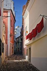 Backstreet of Lisbon, Portugal (pas le matin) Tags: street blue red sky portugal rouge calle alley lisboa lisbon backstreet bleu ciel laundry rua ruelle rue linge lisbonne callejn