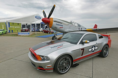 EAA / Ford Tuskegee Airmen tribute (twm1340) Tags: charity ford wisconsin magazine experimental fighter auction aircraft wwii company website convention ww2 motor annual mustang wi association eaa oshkosh airventure 2012 lagunaseca p51 airmen northamerican tuskegee naa redtails p51c 2013 boss302 assn motortrend