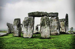 Ancient Stonehenge (` Toshio ') Tags: england history grass rain rock clouds moss ancient europe unitedkingdom stormy stonehenge historical druid raining europeanunion toshio