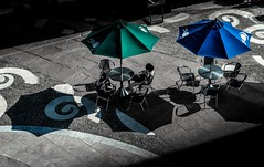 Enjoying the sun (watchthewrld) Tags: umbrella japan nagasaki canal city urban shadows lines shapes relax sun travel jp blue green light