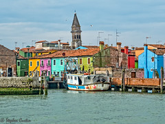 Burano Fishing Boat (stephencurtin) Tags: fishing boat burano italy houses colorful steeple tower rust