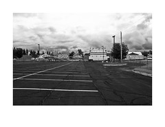 Saint Louis County Fair, Chisolm, Minnesota (Richard C. Johnson: AKA fishwrapcomix) Tags: leicaq summilux28mm f17 paxamericanus endofempire digital countyfair chisolm minnesota blackandwhite bw monochrome carnival outdoor comingstorm thegreatrecession thesunsetsinthewest thesunrisesintheeast clouds parkinglot vehicles rides duluth civisromanussum midwest concessions