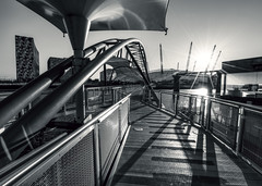 North Greenwich (vulture labs) Tags: street city uk travel bridge light sunset england sky urban bw sunlight white black building brick london art water lines thames skyline architecture modern skyscraper river landscape photography pier photo nikon europe exposure industrial cityscape shadows angle pov 4 capital curves greenwich wide perspective structure millennium dome nikkor hdr flares cityoflondon lightrays lightroom northgreenwich londonskyline splittoned photomatix d700 o2arena 1424mm vulturelabs
